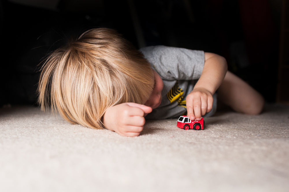 little boy playing with fire truck on carpet | Huntsville photographer