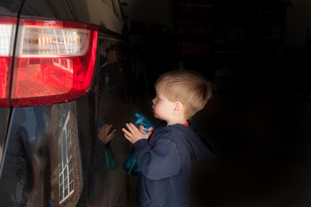 little boy spraying car | Huntsville photographer
