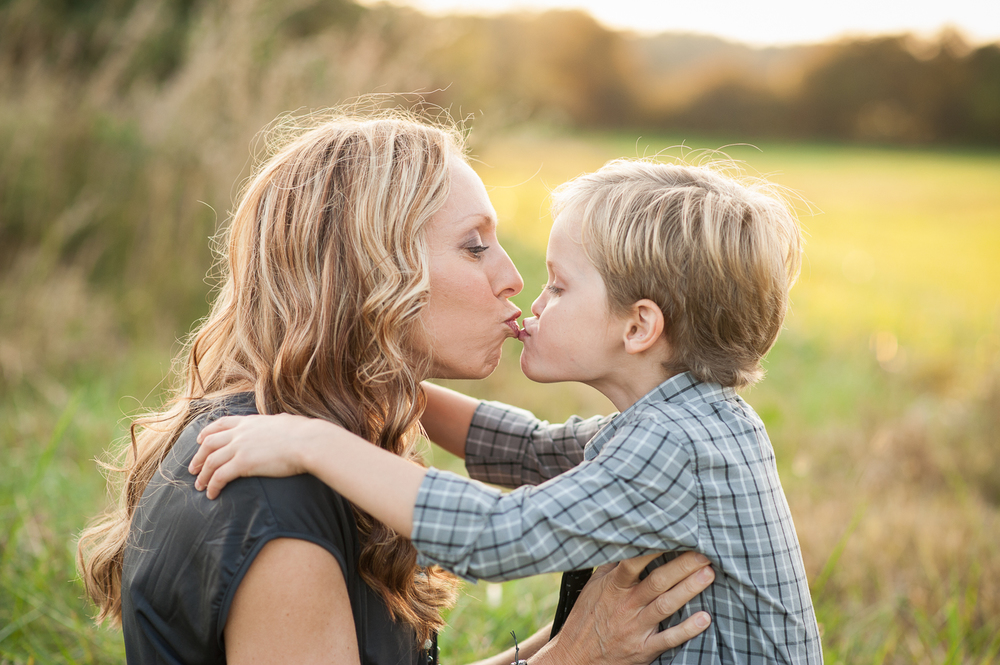 mom kissing son in field | Huntsville family photographer