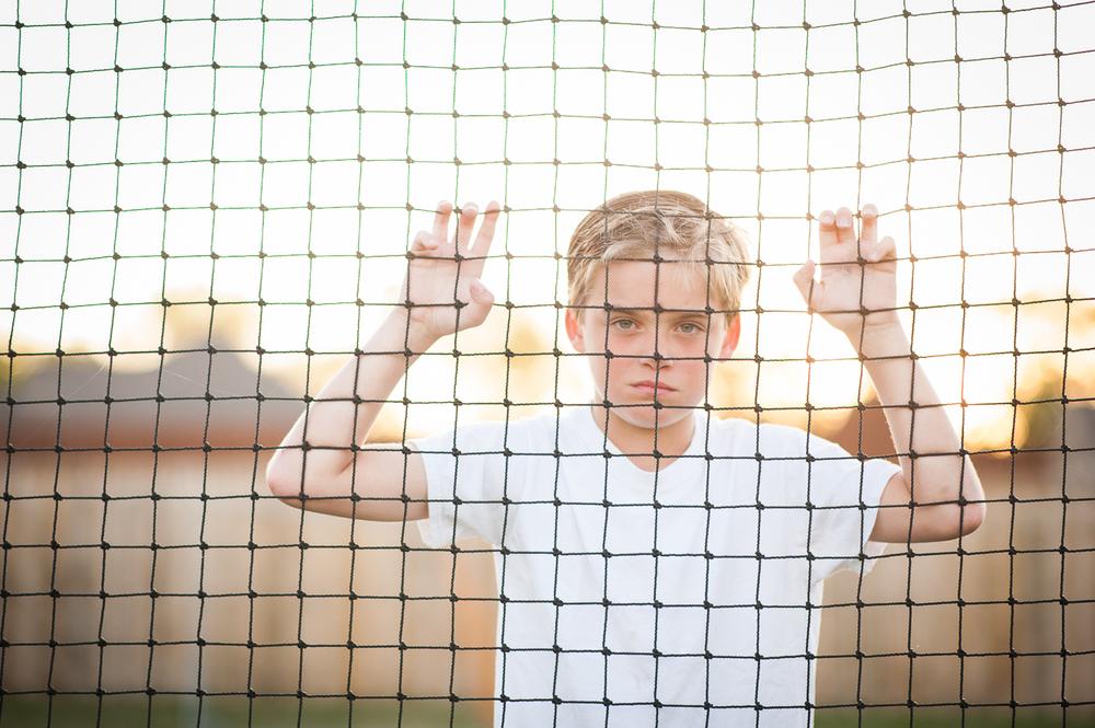 boy looking through soccer goal | Huntsville photographer