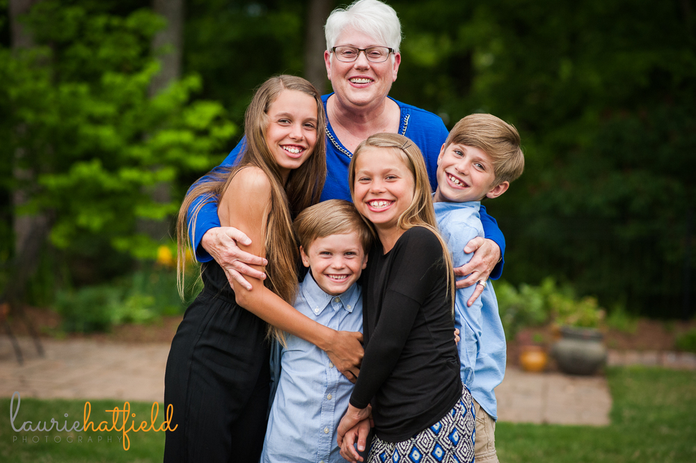 grandmother hugging 4 grandchildren | Huntsville photographer