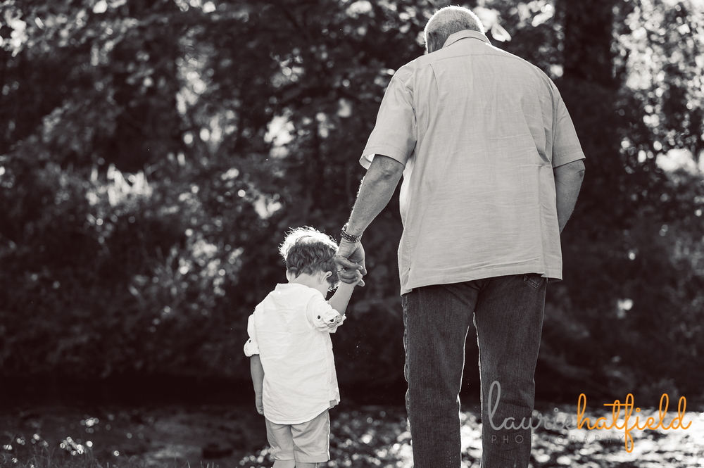 grandfather holding hands with grandson | Huntsville family photographer
