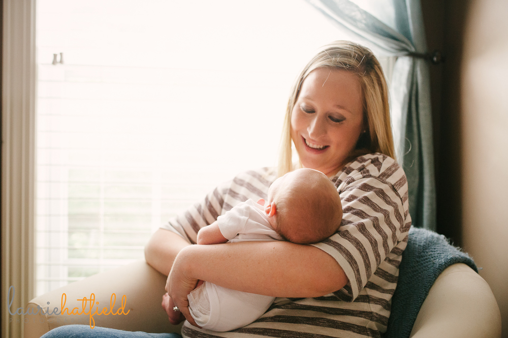 mom sitting and holding new baby | Huntsville AL newborn photos