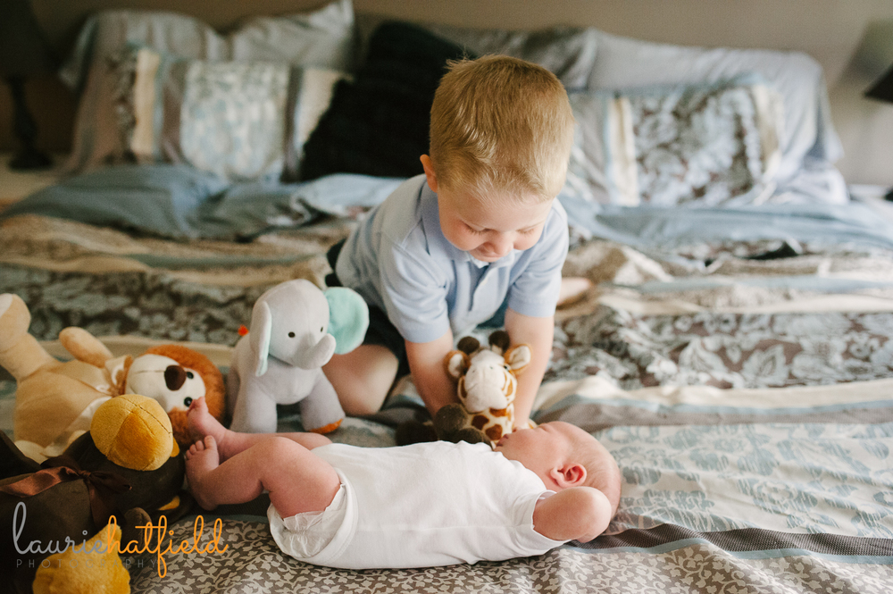big brother playing with new baby | Huntsville newborn photographer