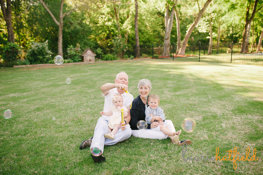 grandparents blowing bubbles with grandchildren | Huntsville photographer