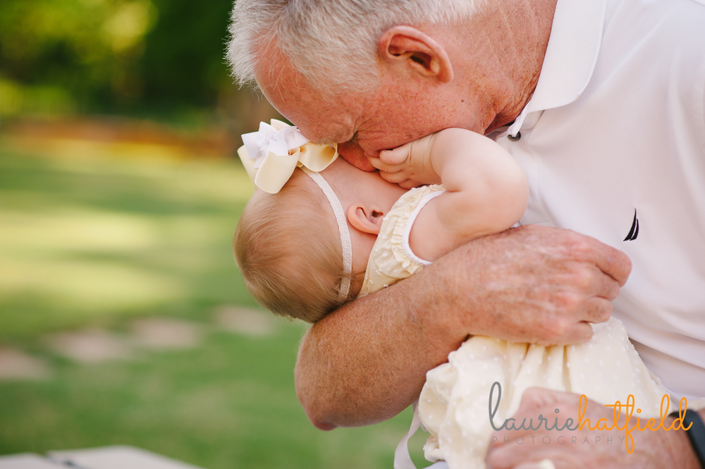 grandfather kissing baby granddaughter | Huntsville photographer