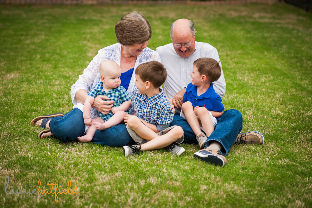 grandparents sitting on grass with three grandsons | Huntsville family photographer