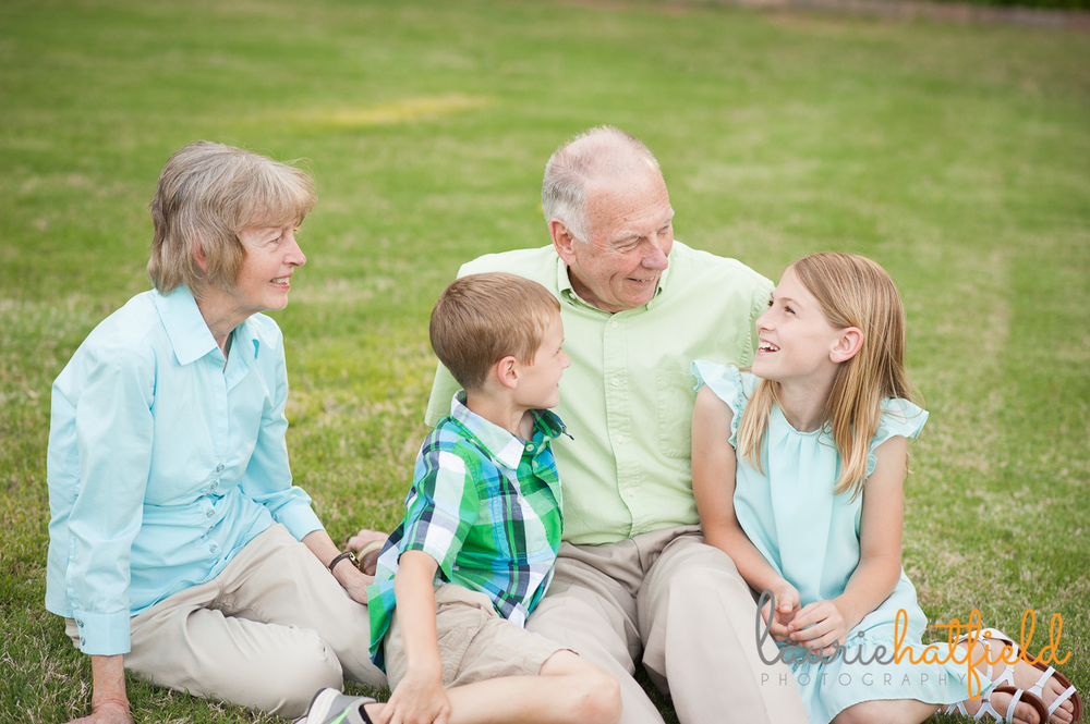grandparents sitting on grass with grandchildren | Huntsville family photographer