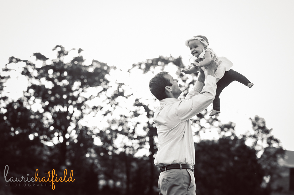 dad tossing baby in air | Huntsville photographer