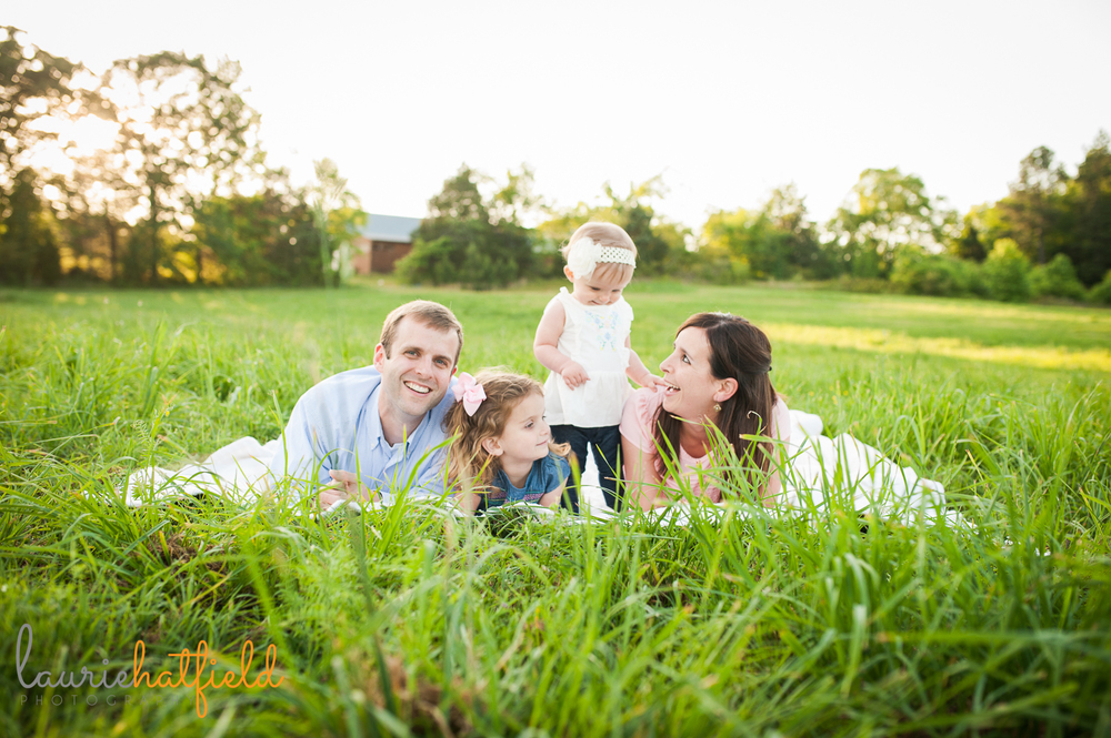 family of four on  blanket in grass | Huntsville photographer