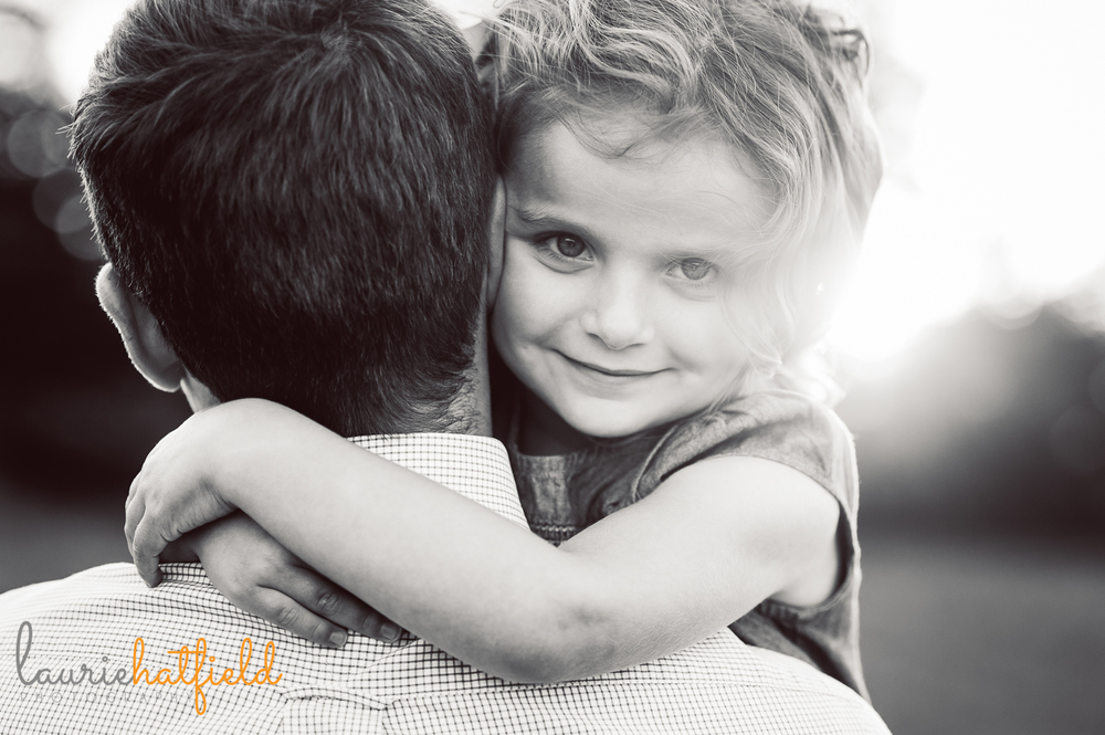 girl peeking over dad's shoulder | Huntsville child photographer