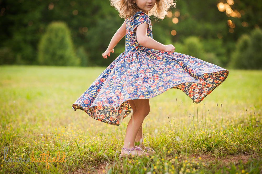 little girl in dress twirling | Huntsville family photographer