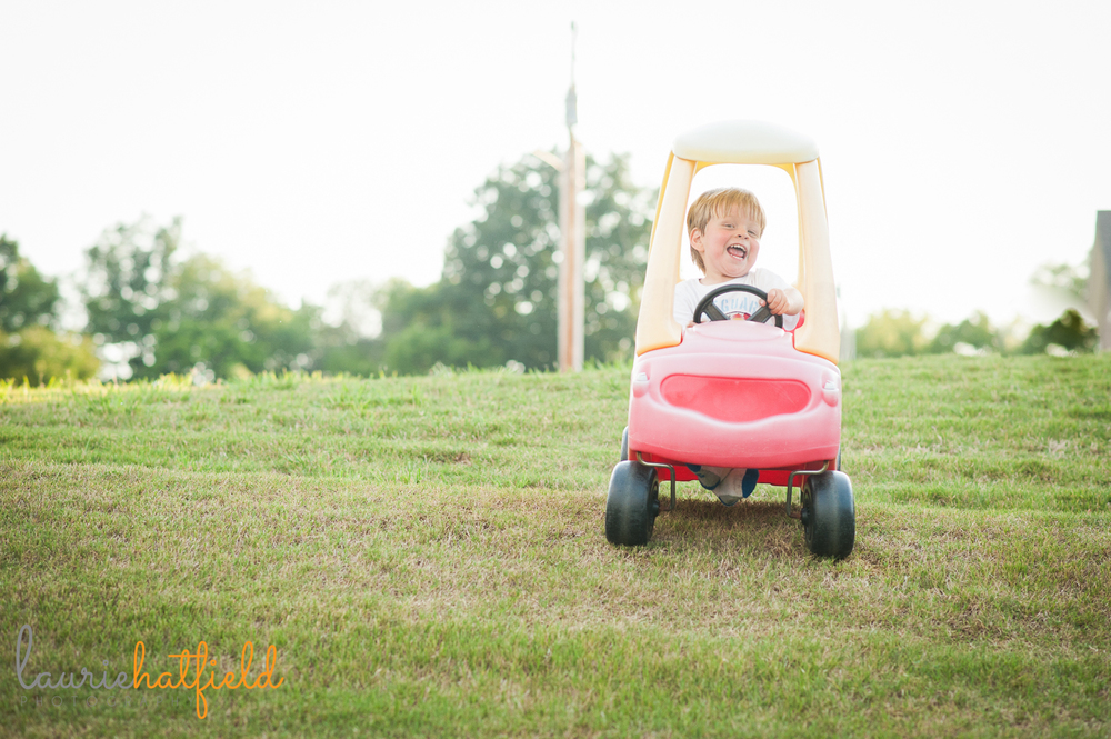 3-year-old riding Cozy Coupe | Huntsville family photographer