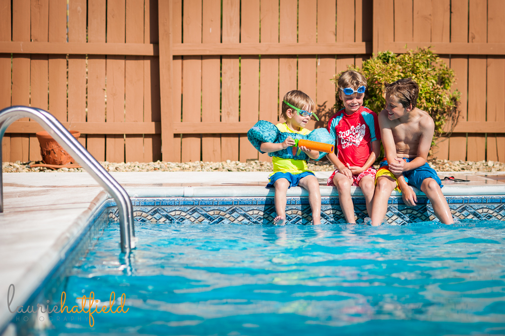 three brothers sitting around pool | Huntsville photographer