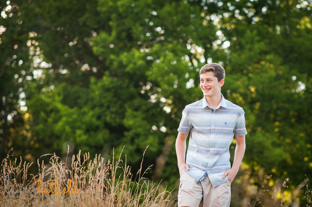 teenage boy walking in field | Huntsville senior photographer