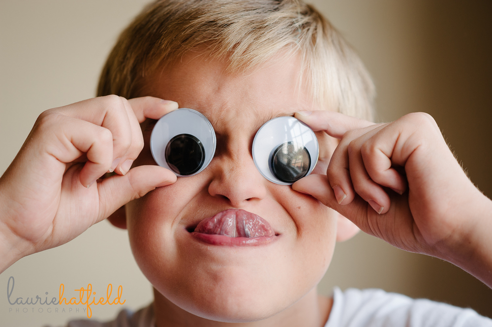 10-year-old boy with google eyes | Huntsville family photographer