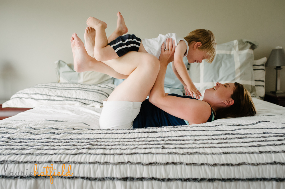 mom and son playing on bed | Huntsville photographer