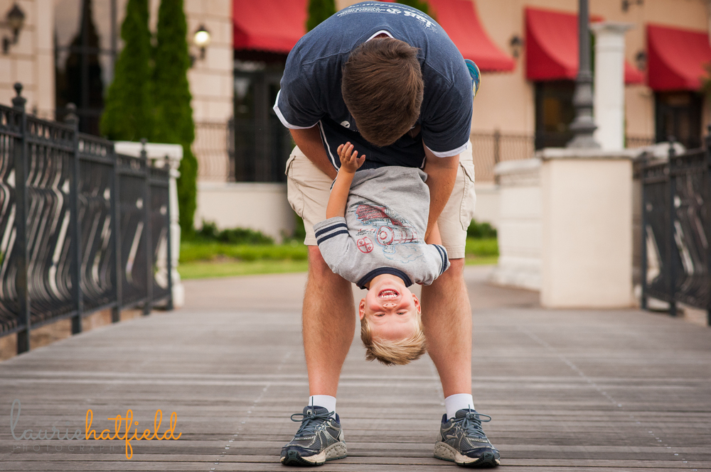 dad holding son upside down | Huntsville photographer