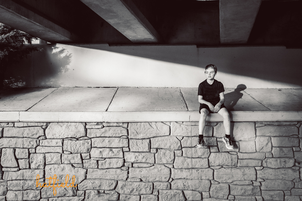 boy sitting on wall with shadow | Huntsville child photographer