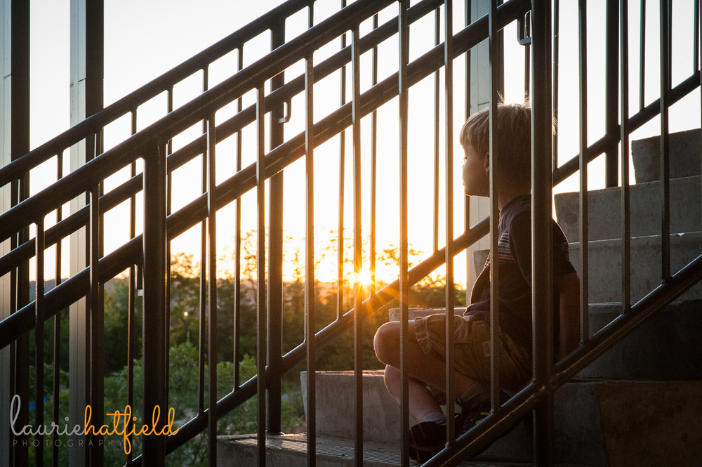 little boy on staircase at sunset | Huntsville family photographer