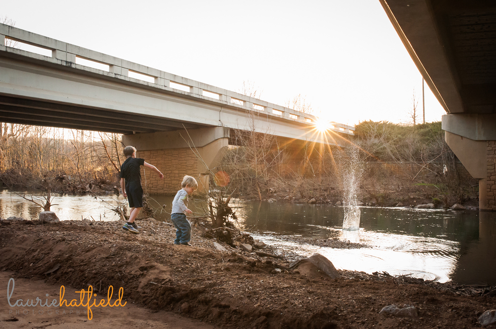 two boys throwing rocks into creek | Huntsville family photographer