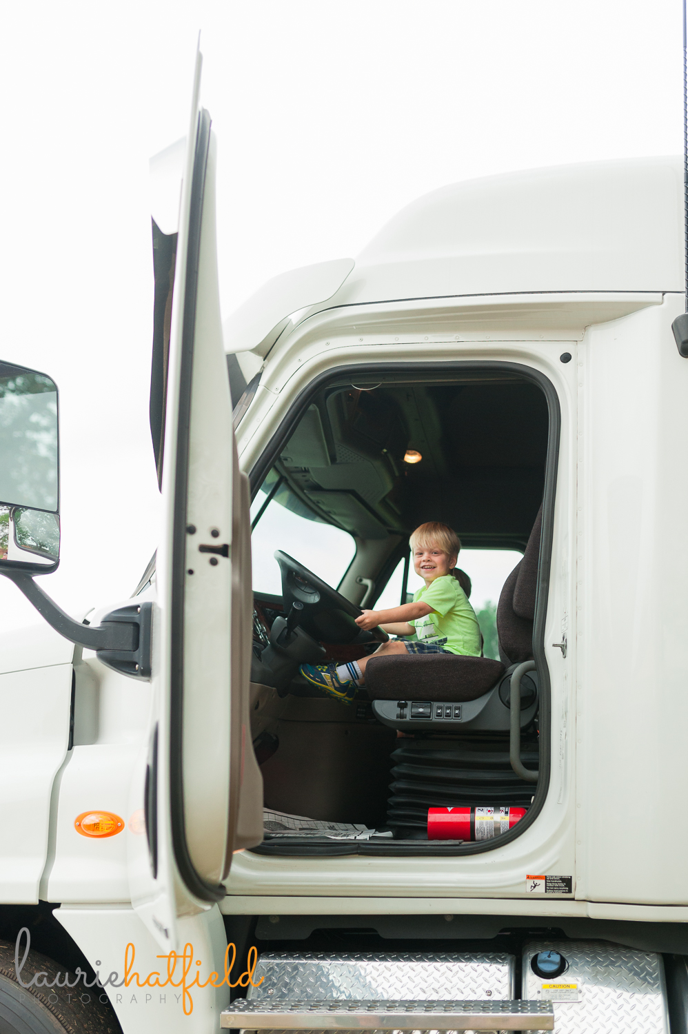 3-year-old in cab of truck | Huntsville child photographer