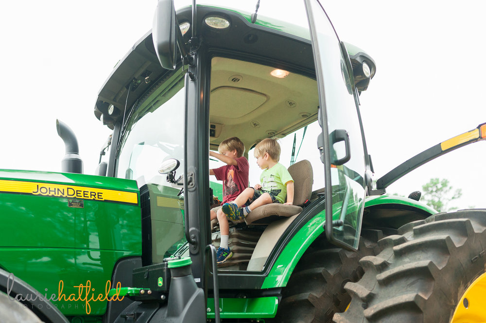 2 brothers sitting in tractor | Huntsville photographer