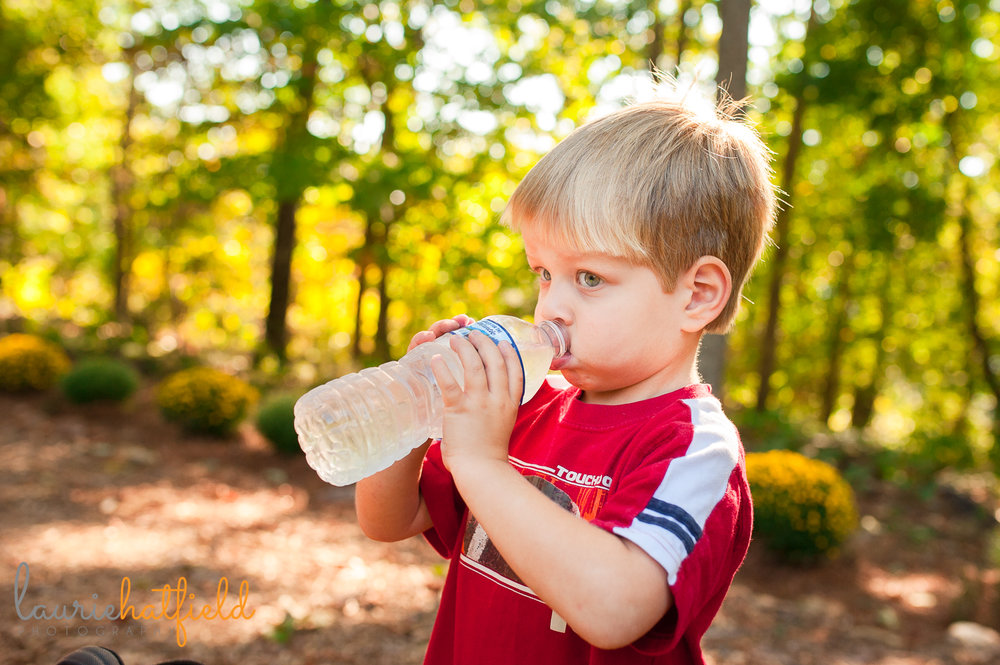 3-year-old boy drinking from a water bottle | Huntsville child photography