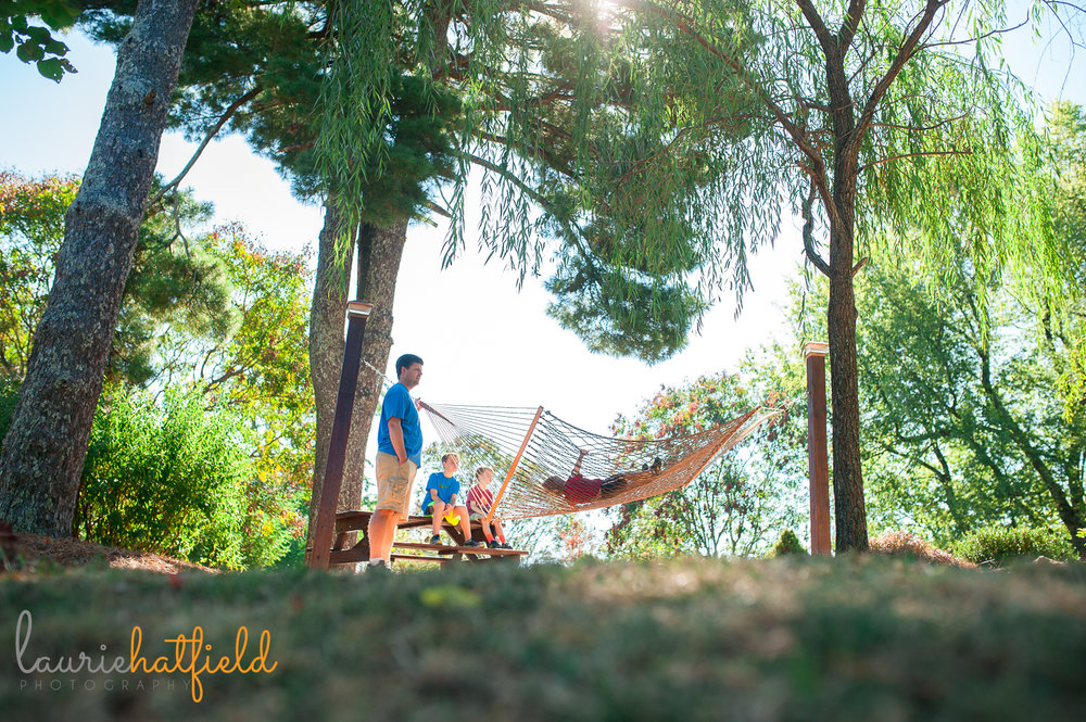little boy swinging on a hammock | Huntsville AL family and child photographer