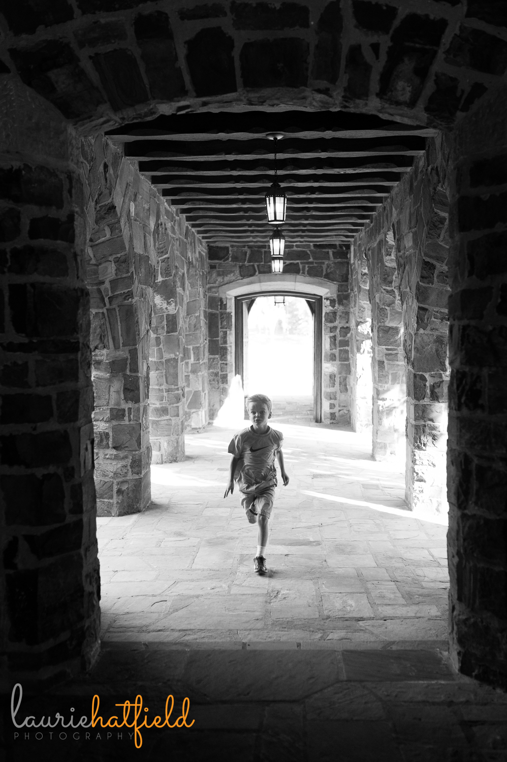 boy running at Frost Chapel at Berry College | Huntsville AL family photographer