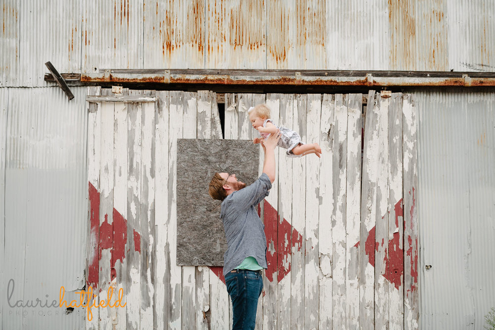 dad tossing baby girl in air | Mobile AL family photographer