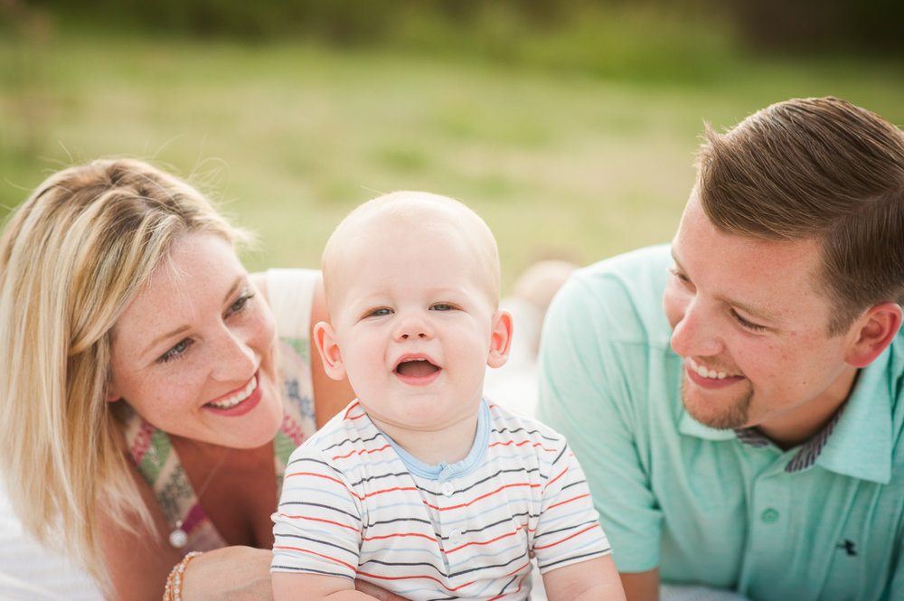 family of three in grass | Mobile lifestyle photographer