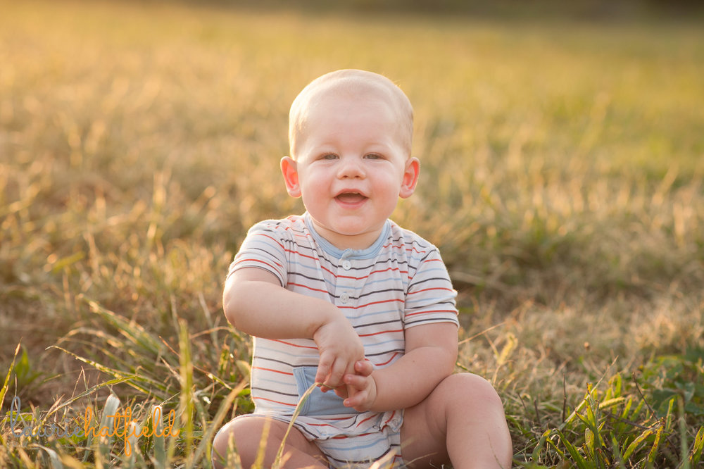1-year-old baby boy sitting in field | Mobile family photographer