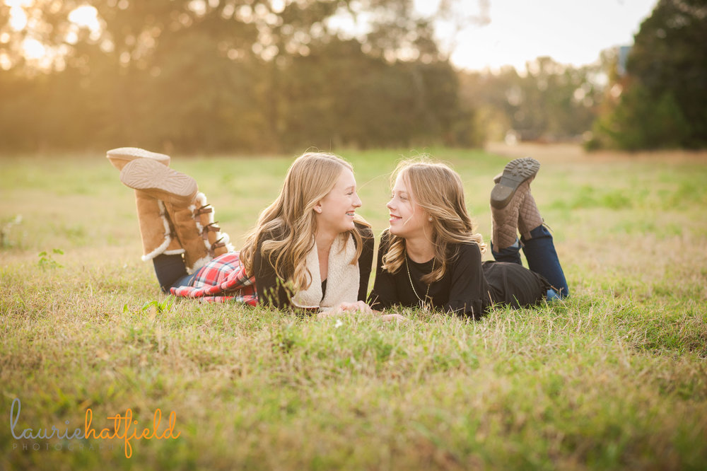sisters lying down in a field | Mobile family photographer