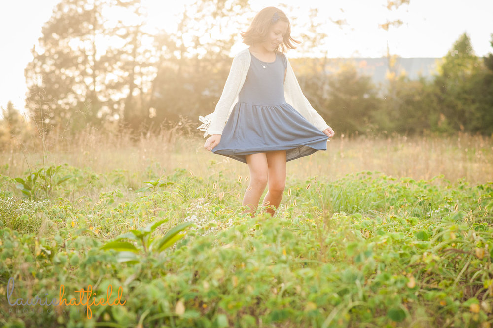 girl twirling in grass | Mobile family photographer