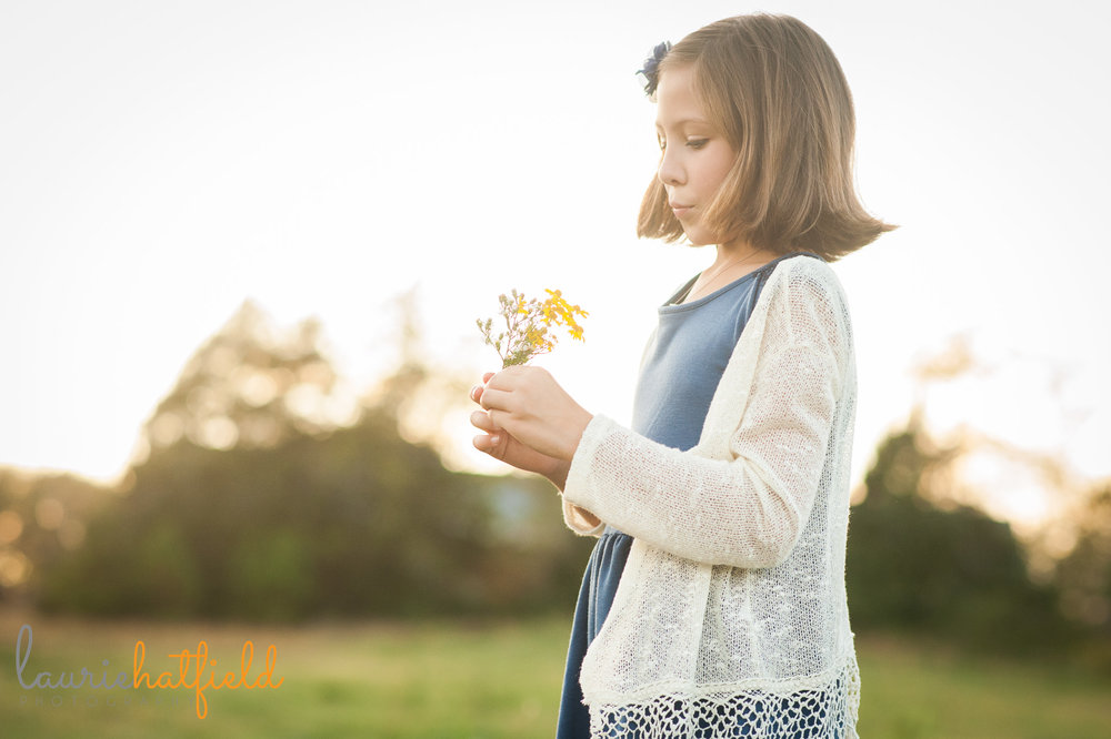 girl in blue dress holding yellow flower | Mobile family photographer