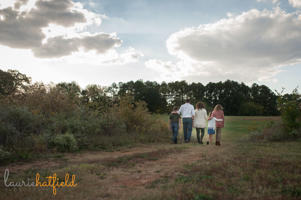 family of 5 walking in a field | Mobile AL photographer