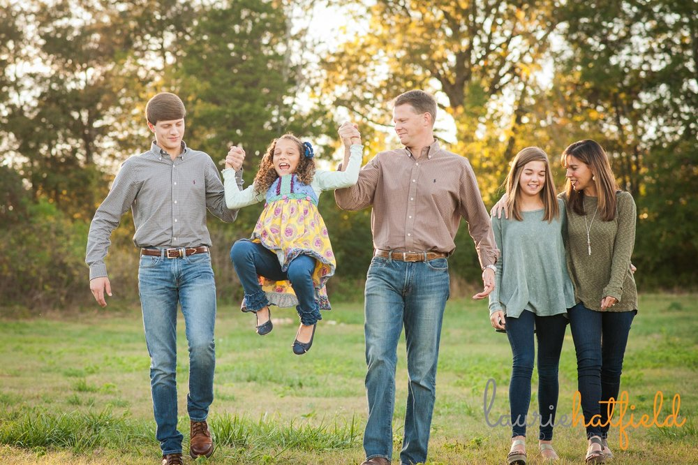 family of five walking through a field | Mobile AL photographer