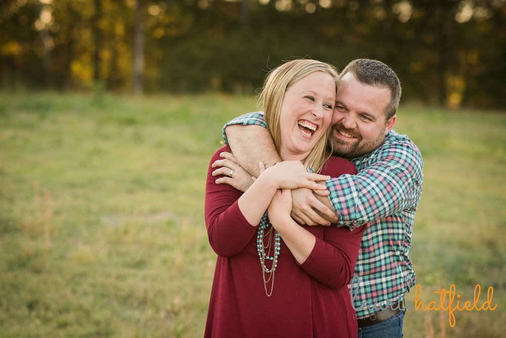 couple laughing and embracing | Mobile AL family photographer