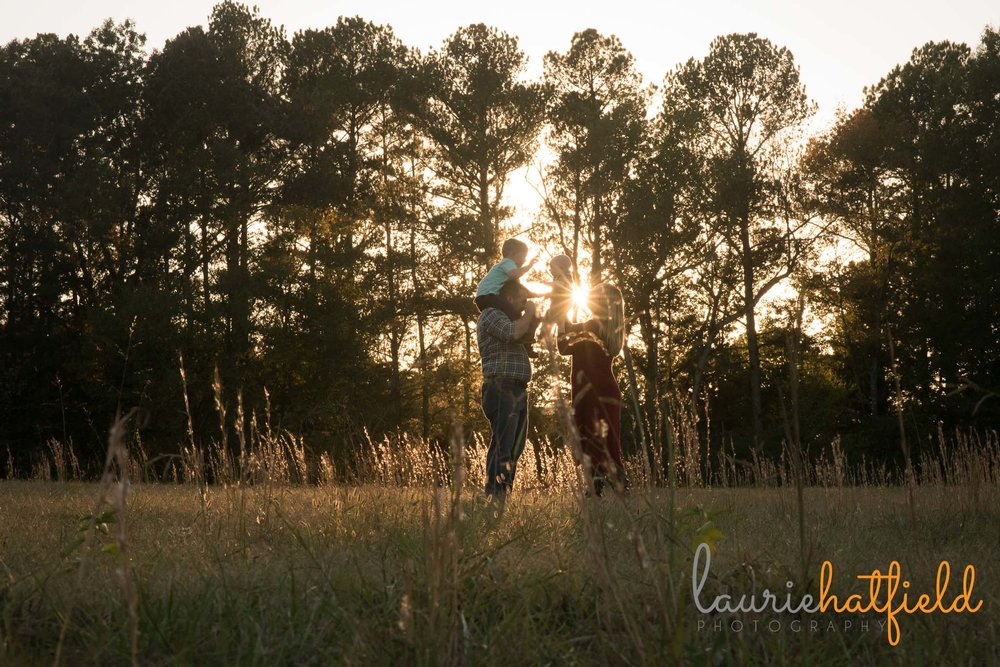 family of four walking through field | Mobile AL lifestyle photographer