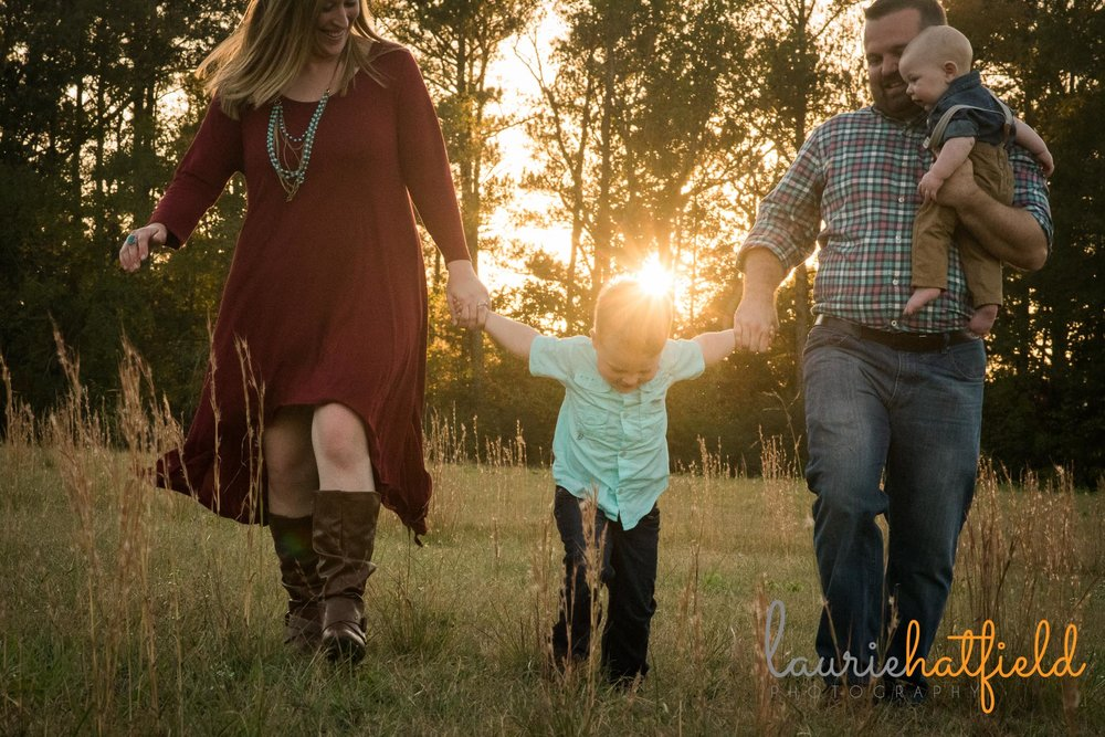family of four walking through field | Mobile AL lifestyle photography