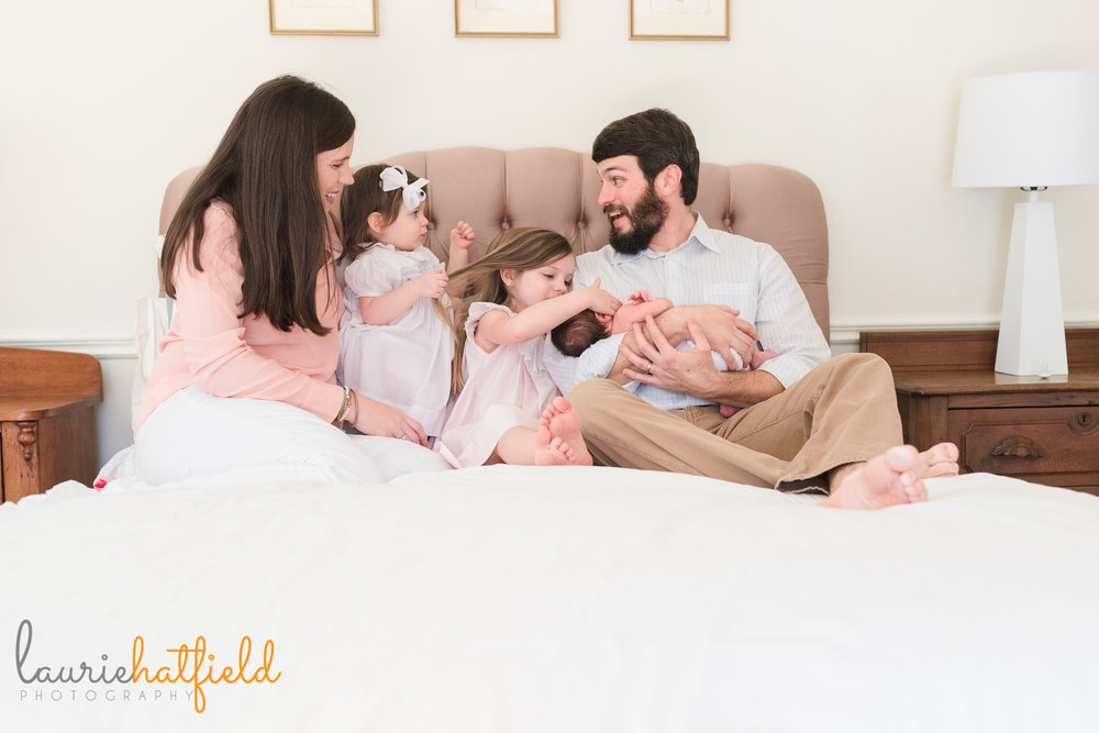 family of five on bed with new baby | Mobile AL newborn photographer