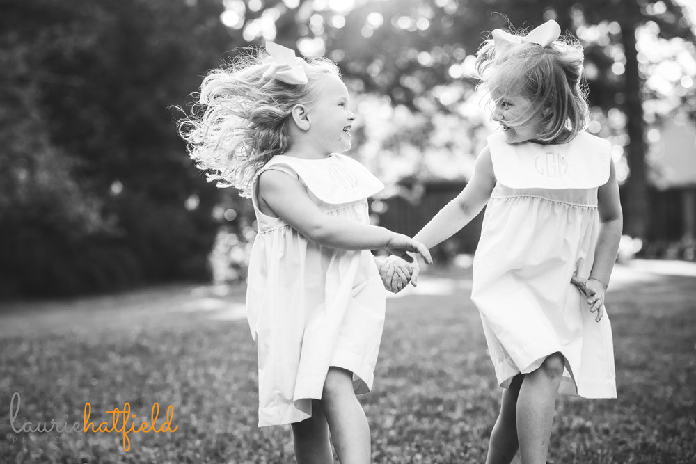 2 sisters skipping | Mobile AL family photographer Laurie Hatfield Photography