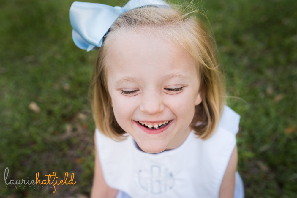 6-year-old girl laughing in grass | Mobile AL family and child photographer | Laurie Hatfield Photography