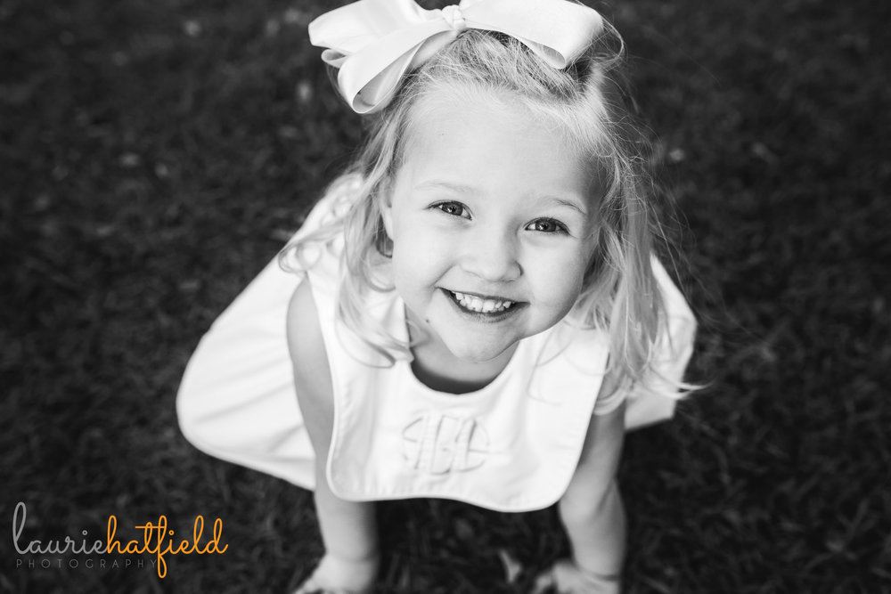 little girl in grass | Mobile AL family photographer | Laurie Hatfield Photography