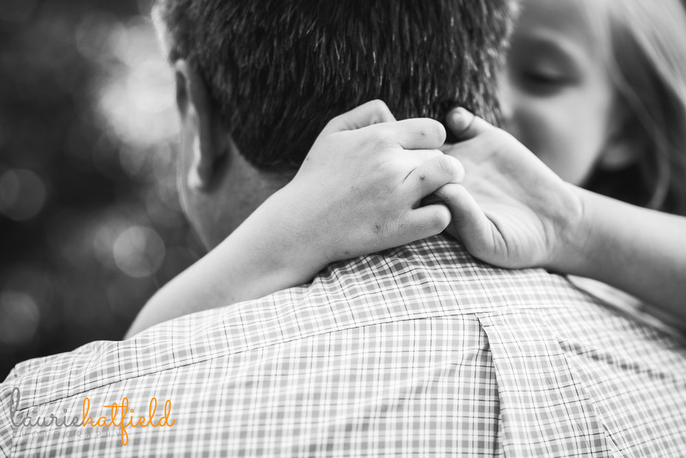 little girl holding onto Dad | Mobile AL family photographer Laurie Hatfield Photography