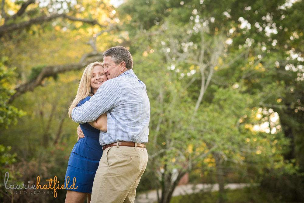 couple hugging by Mobile AL family photographer Laurie Hatfield Photography