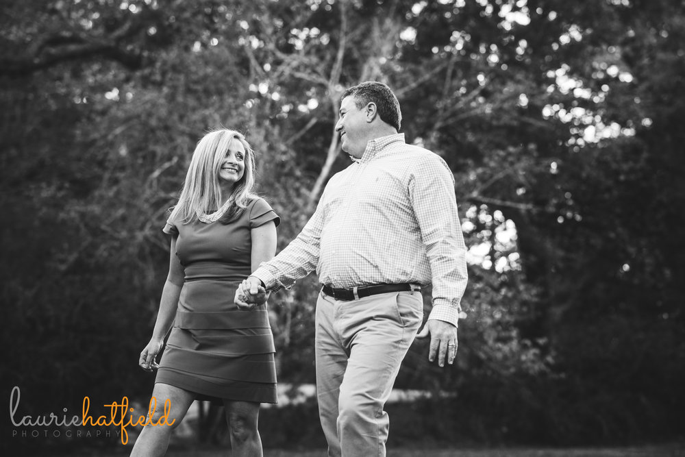 mom and dad walking together by Mobile AL family photographer Laurie Hatfield Photography