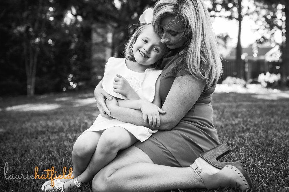 mom holding little girl by Mobile AL family photographer Laurie Hatfield Photography