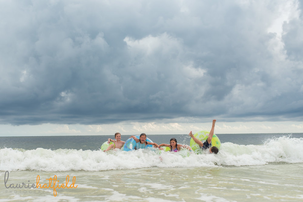 kids on floats in ocean | Mobile AL family photographer